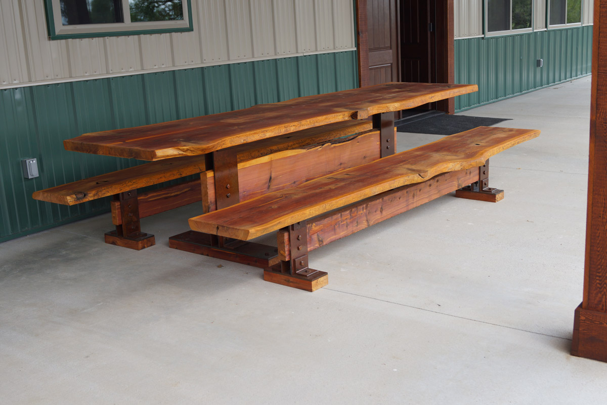 Live Edge Native Red Cedar Planks Are Book Matched With Bow Tie Inlays.  Supported With Rustic Patina Legs.